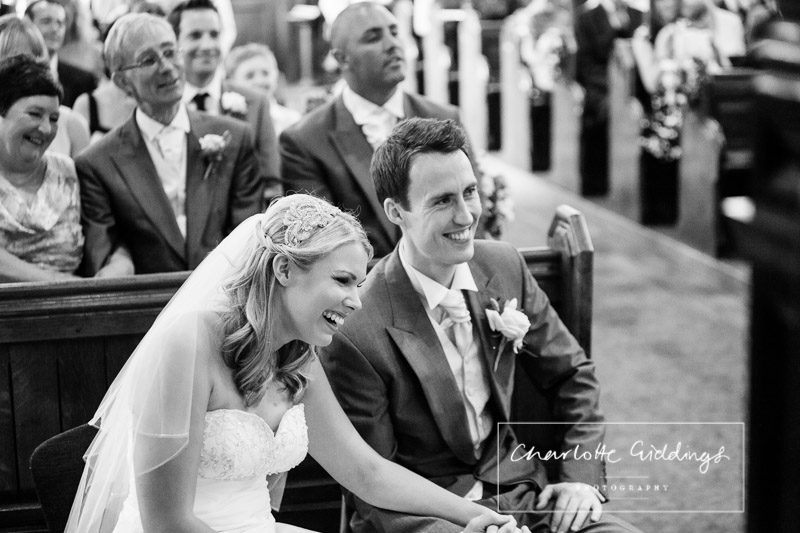bride and groom laughing out loud in church