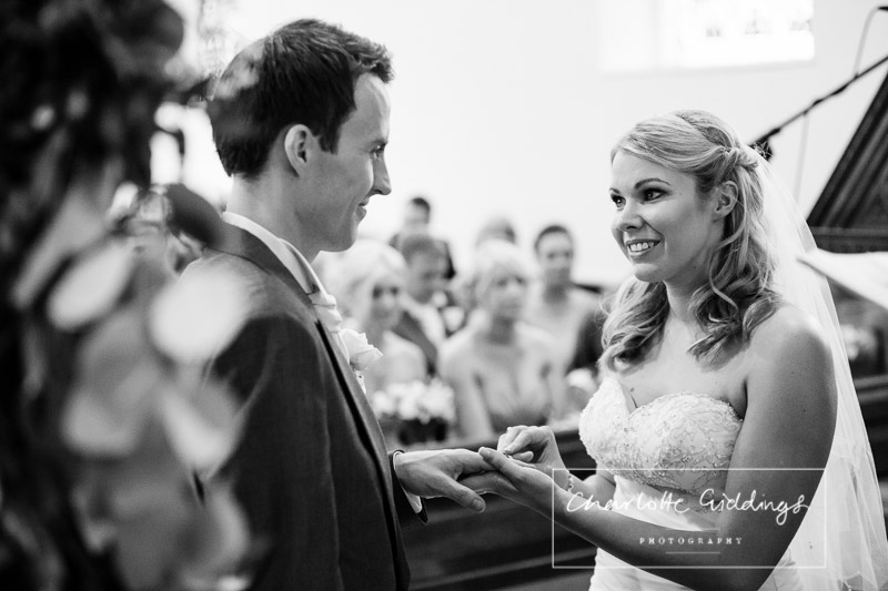 bride and groom exchanging vowels and rings