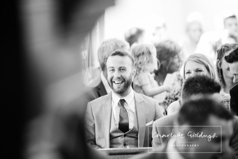 friend laughing during wedding ceremony