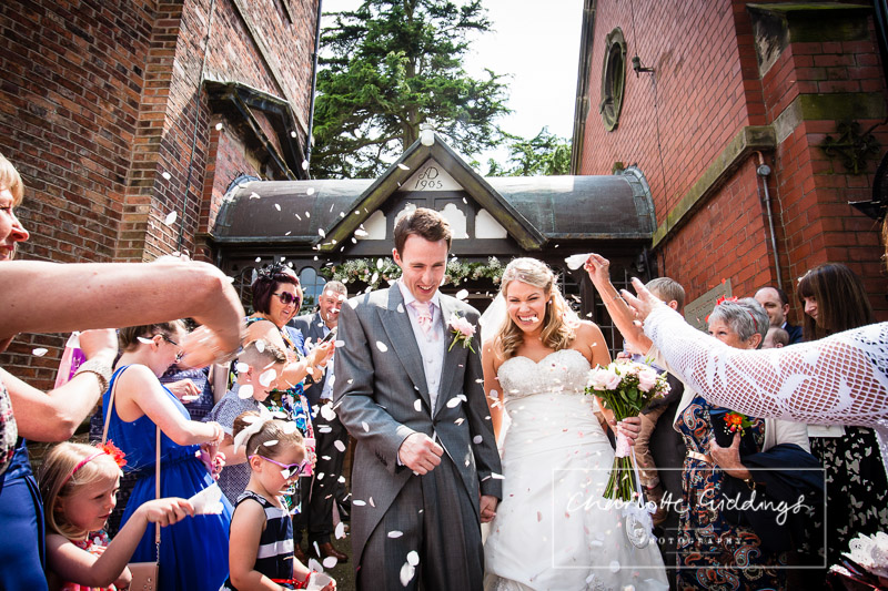 bride and groom confetti at st.marys church wistaton