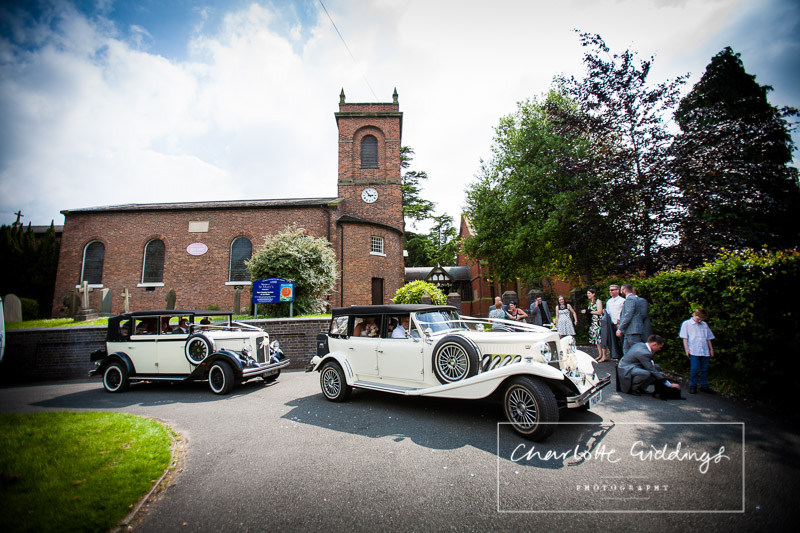bride and groom leaving church in wedding car