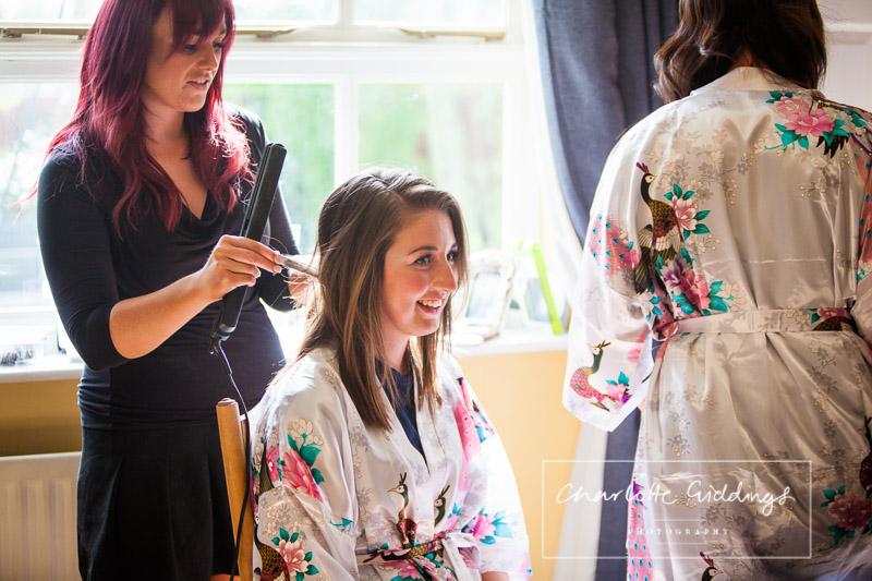 bridemaid having her hair done at home - bridal prep - shropshire wedding photographer