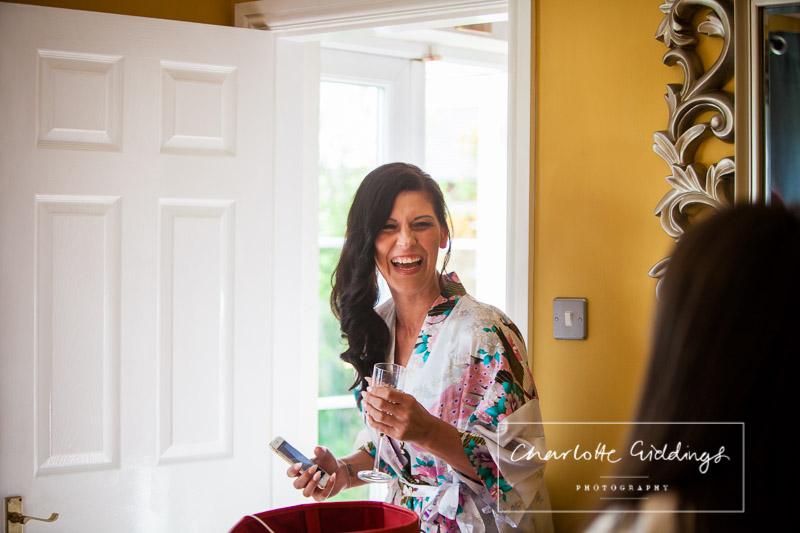 a very happy bridesmaid getting ready at home - heaton house farm wedding
