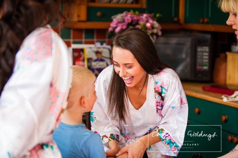 bridesmaid playing around with the pageboy - heaton house farm wedding