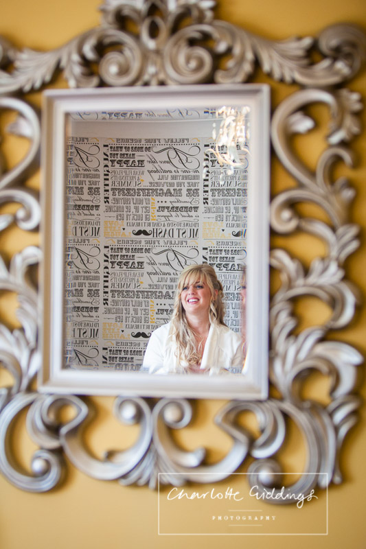 reflection of the bride in the mirror - bridal preparations at home, cheshire