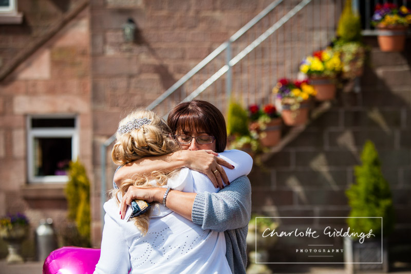 mother of the groom hugging the bride - charlotte giddings photography