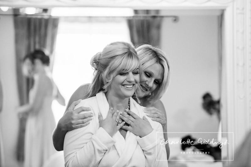 bridesmaid having a moment with bride - shropshire wedding photographer