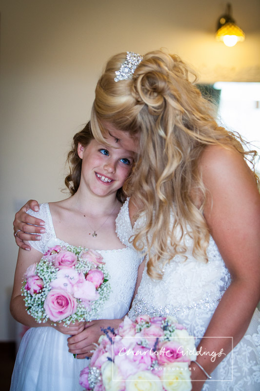 flower girl looking at the bride adoringly at heaton house farm