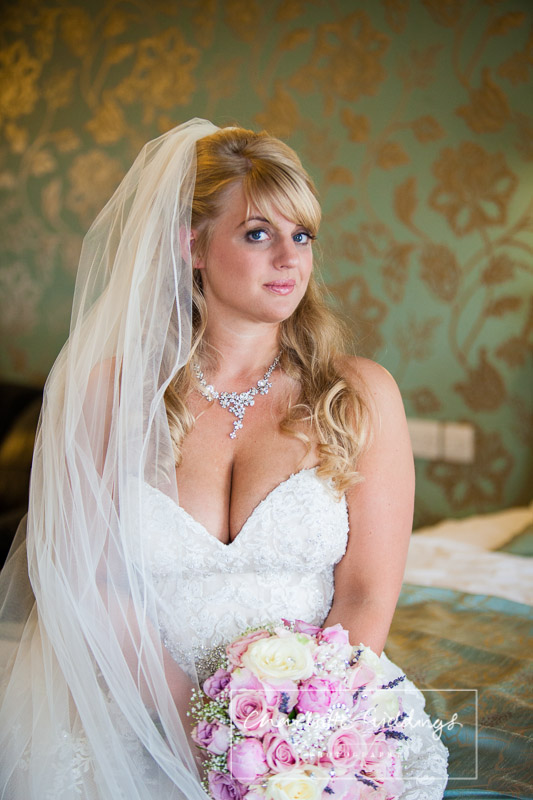 portrait of the bride holding bouquet at heaton house farm wedding