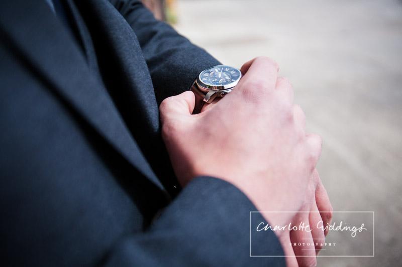 checking the time for heaton house farm wedding