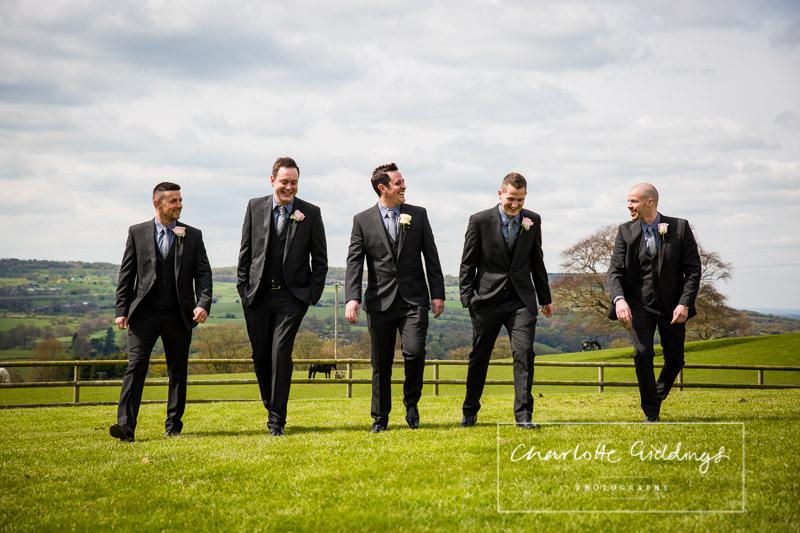 the groom at the boys walking towards wedding ceremony heaton house farm