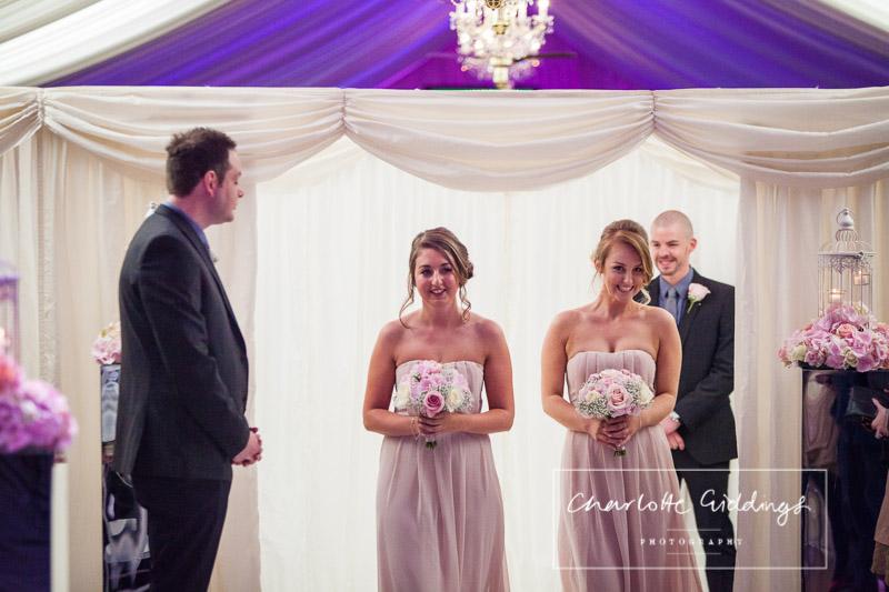 bridesmaids walking down the aisle at heaton house farm wedding