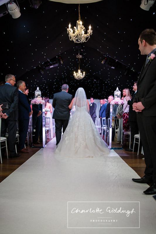bride walking down the aisle at heaton house farm