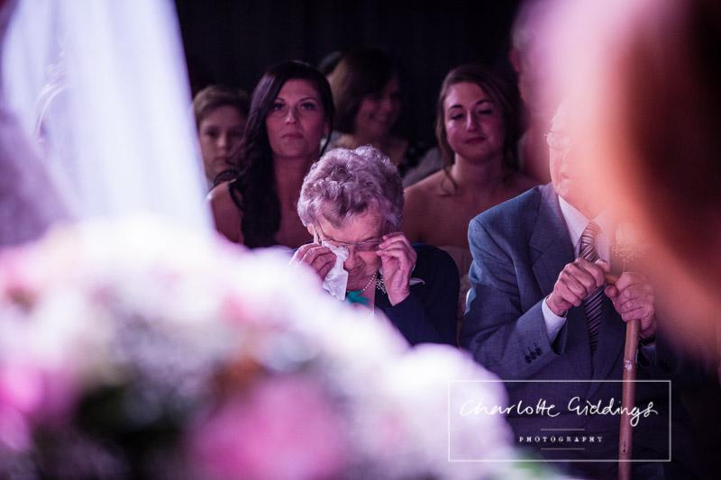 grandma wiping away the tears during ceremony at heaton house farm