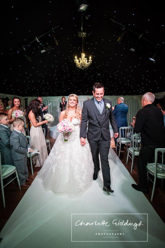 walking down the aisle at heaton house farm wedding ceremony
