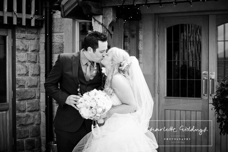 kissing portrait bride and groom end of ceremony staffordshire wedding