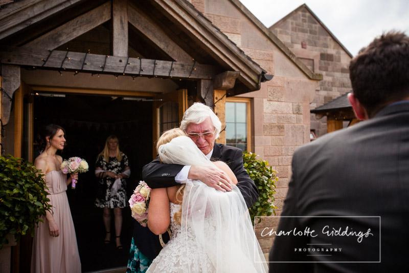 guest congratulating the bride at heaton house wedding summer