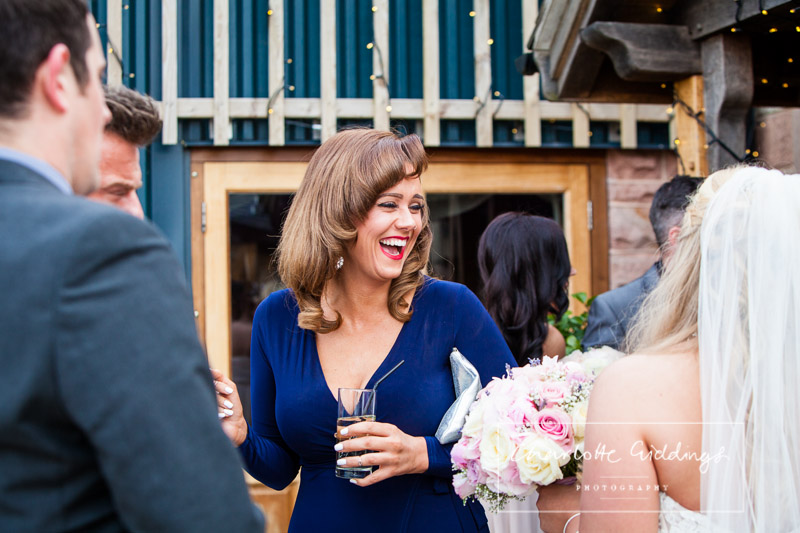 vintage inspired guest laughing with the bride - staffordshire wedding venue
