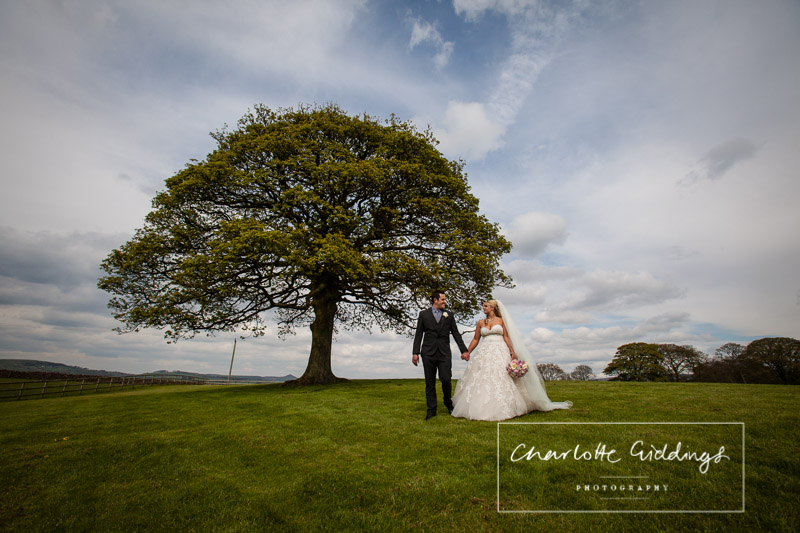 bride and groom having a moment along walking together at heaton house farm wedding venue
