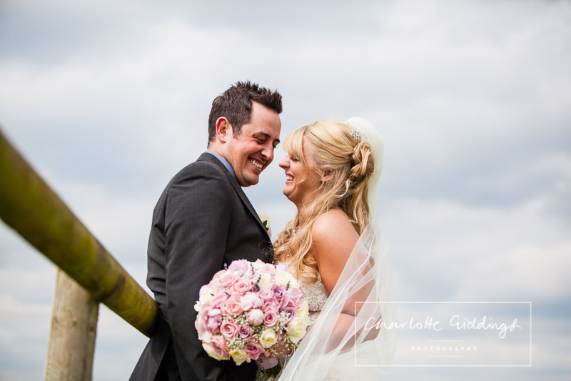 bride and groom having a giggle together at heaton house farm wedding venue