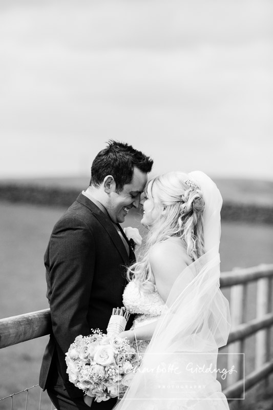 black and white photo of the bride and groom with foreheads touching at heaton house farm