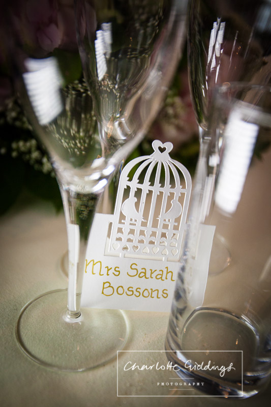 birdcage inspired place setting cards at heaton house farm wedding