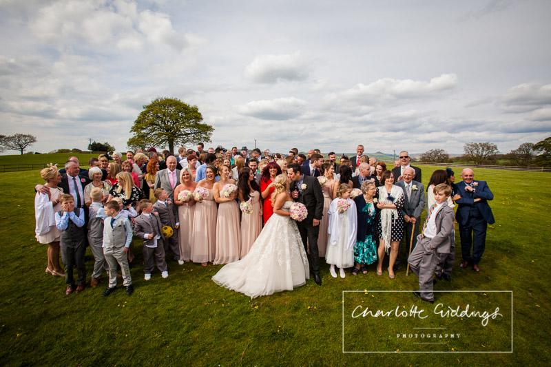 whole group photo outside at heaton house farm - shropshire wedding photographer