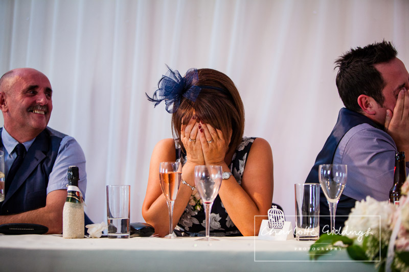 mother of the groom laughing out at speeches - wedding photographer shropshire