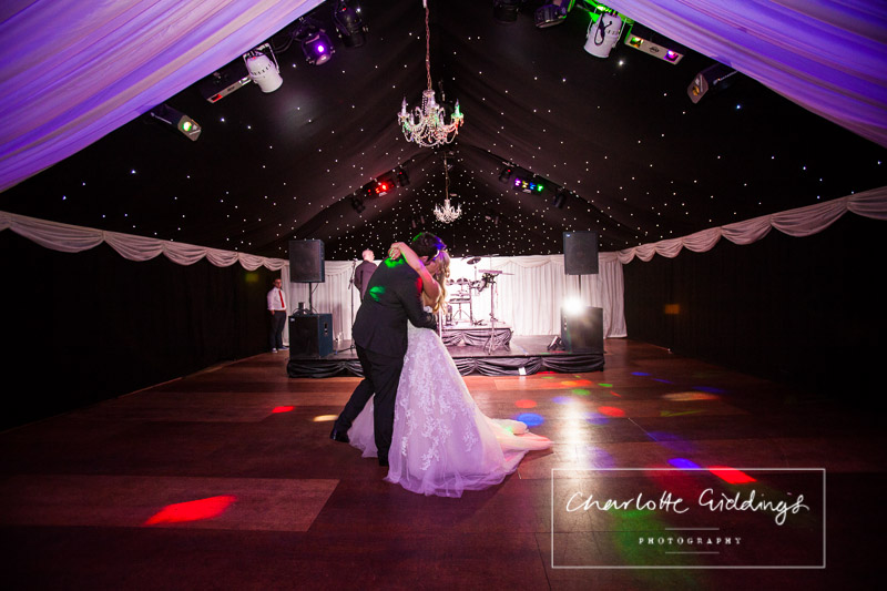 bride and groom kissing during the first dance at heaton house wedding venue - shropshire photographer