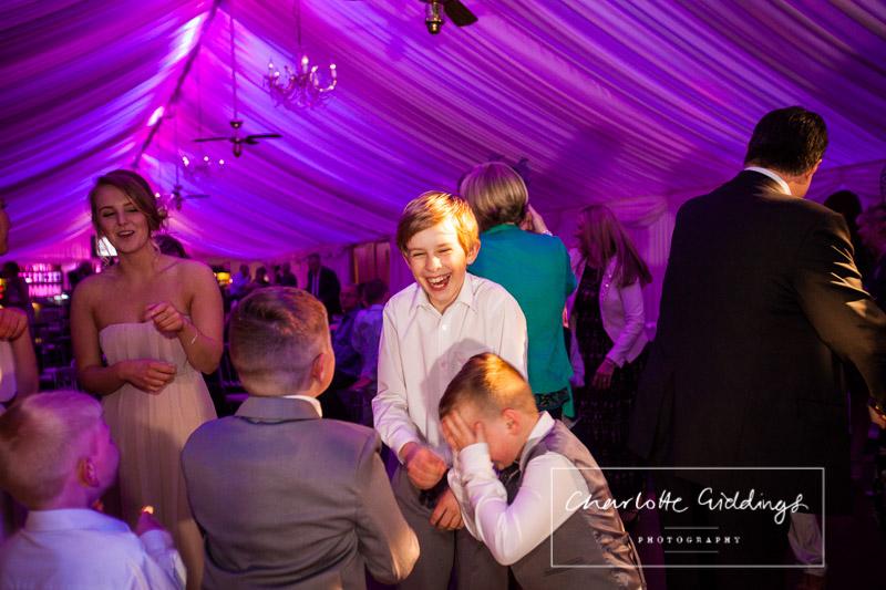 boys laughing and dancing at heaton house farm wedding - shropshire wedding photographer