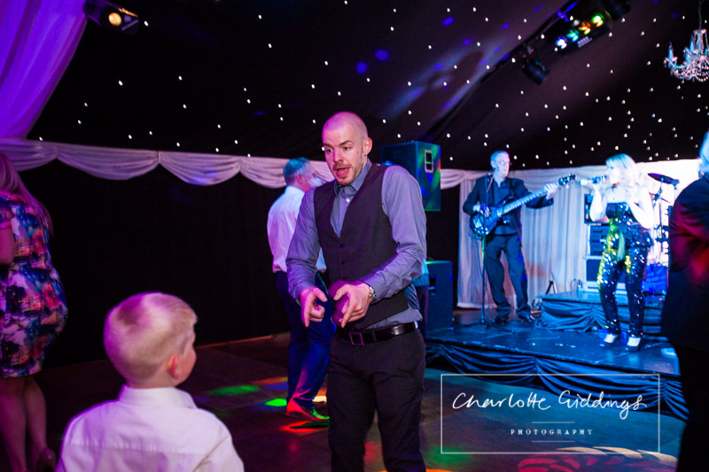 wedding guest busting some moves on the dance floor at heaton house farm - shropshire photographer