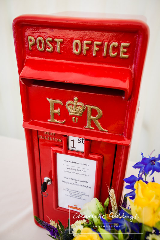 red post box to take receipt of cards and gifts for the bride and groom