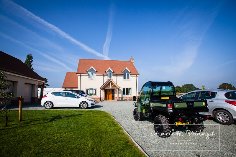 bride and grooms wedding reception venue at home - blue sky in shropshire