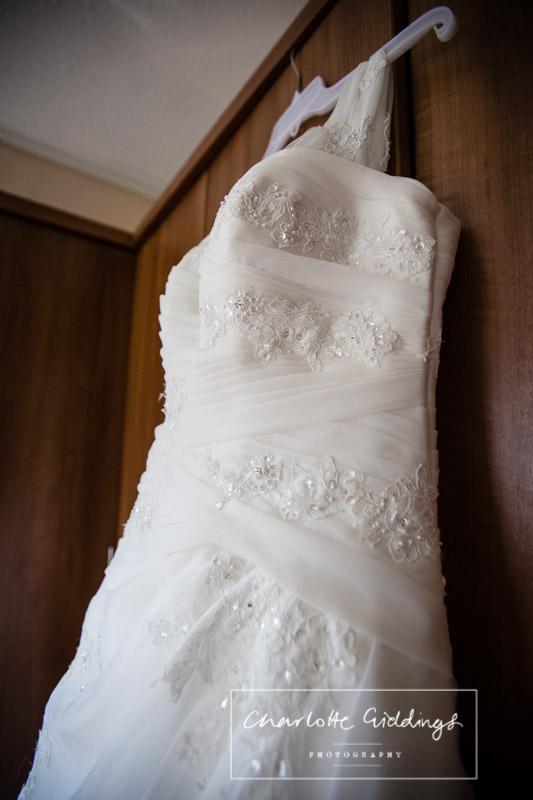 brides wedding dress with lots of beading and straps - shropshire wedding photogarpher