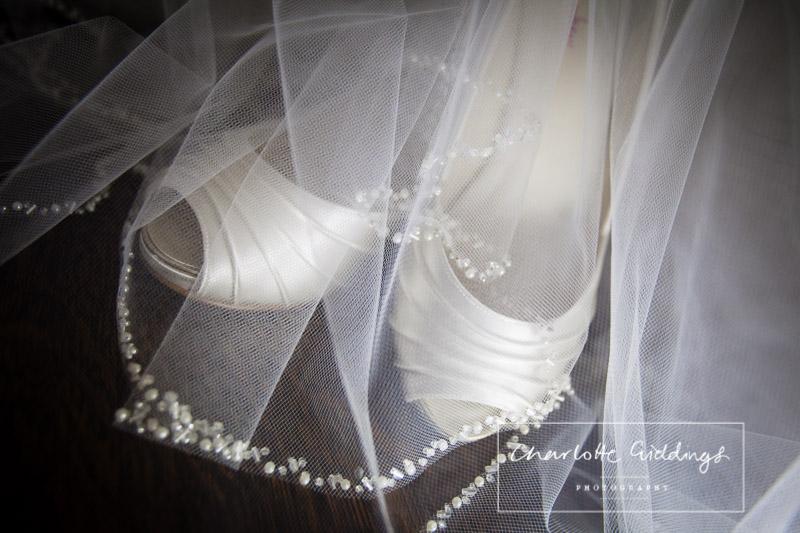 brides ivory wedding shoes, with beautiful beaded veil - wedding photographer shropshire
