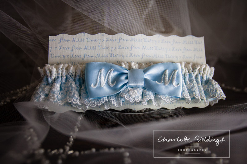 personlised garter with M and M - gift from bridesmaids