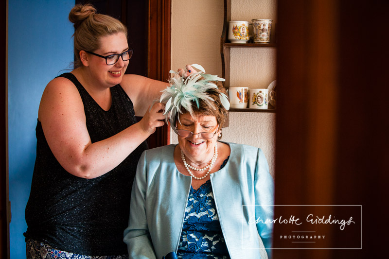 mother of the bride laughing with hair and makeup lady - lauren parker