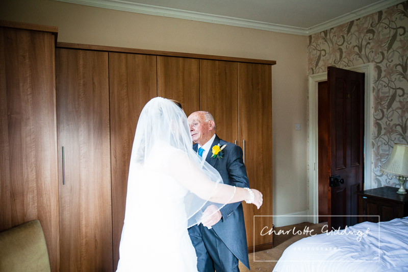father of the bride seeing his daughter for the first time - charlotte giddings photography