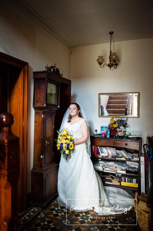 full legth bride portrait by grandfather clock in shropshire home