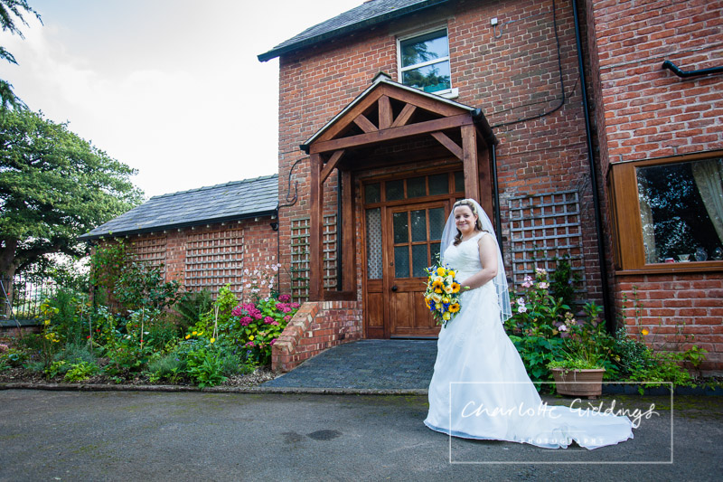 full length photo of the bride outside her family home in shropshire - charlotte giddings photography