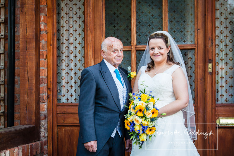 bride and the father of the bride outside the family home together - wedding photographer shropshire