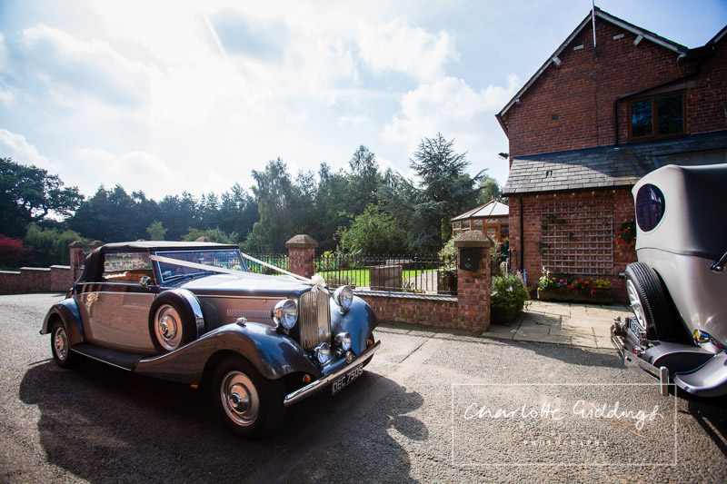 manor bridal cars waiting outside the family farm house ready to go to church