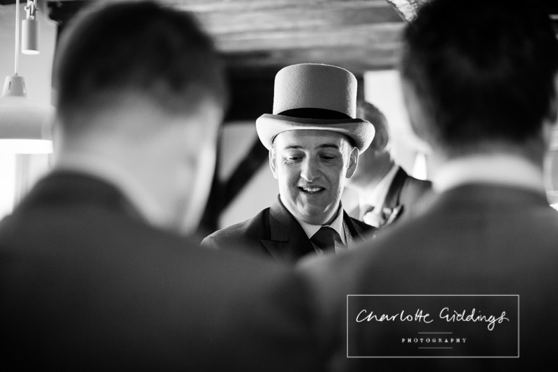 black and white photo of the groom in the pub, black bear, whitchurch shropshire