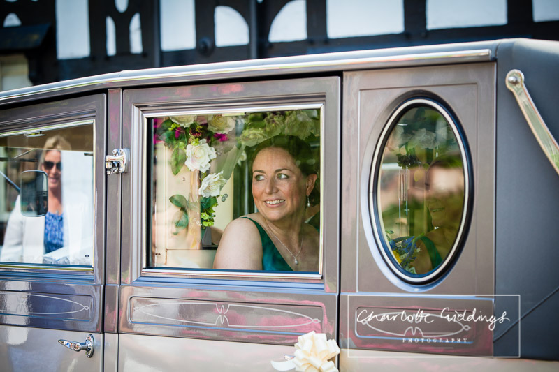 bridesmaid looking out of the window at st. alkmunds church - shropshire photographer