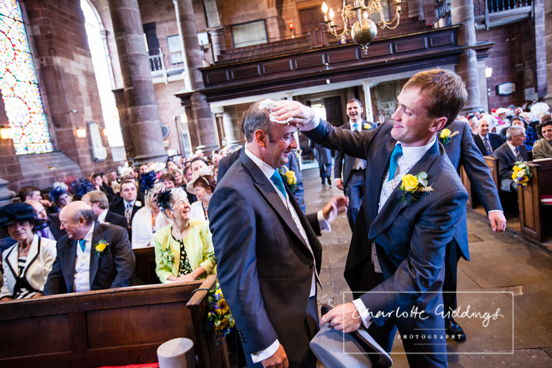best man playfully wiping the grooms brow before the bride arrives - shropshire wedding photographer