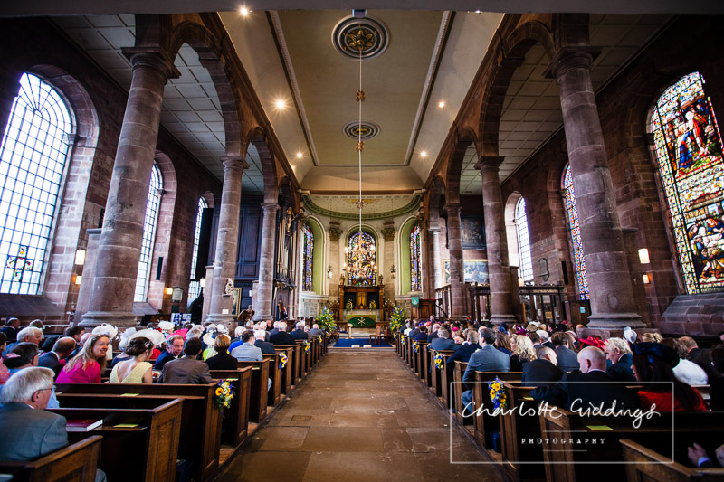 wide angle photo of st. alkmunds church looking towards the alter before the wedding ceremony begins