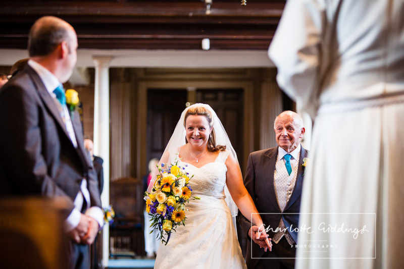 groom turns around to look at his bride with the biggest beautiful smile on her face as her dad - shropshire wedding photographer