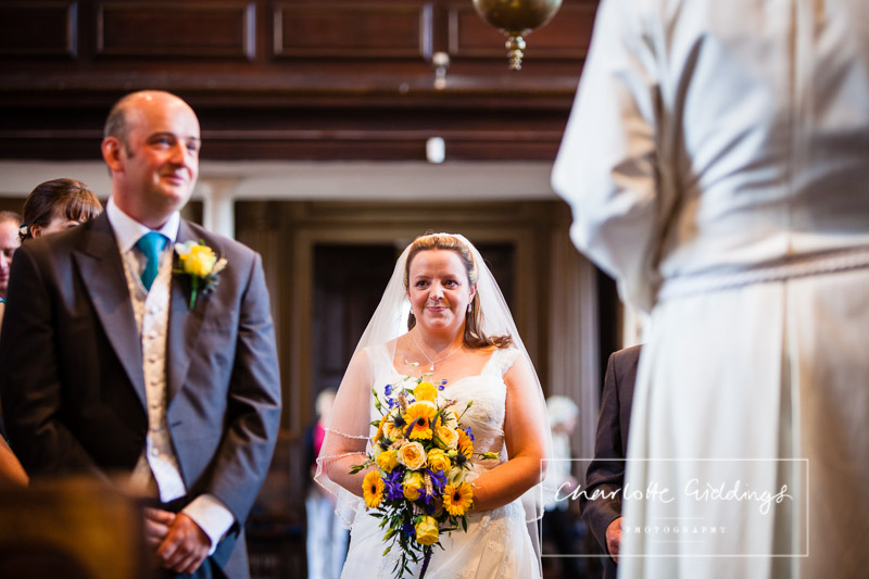 over the moon bride looking at her groom and the groom with a pleased as punched face in the foreground - whitchurch wedding photographer