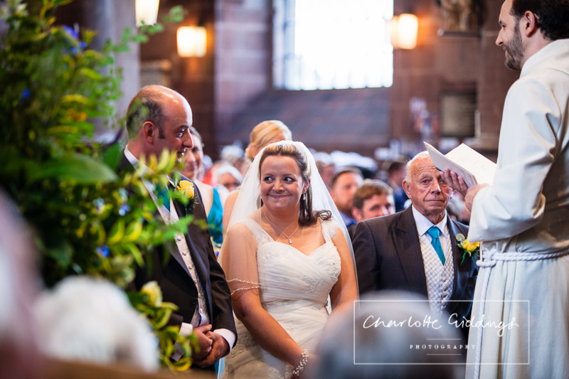 bride looking extremely happy as she looks at the groom - charlotte giddings photography