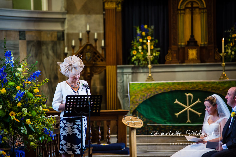wedding guest doing a reading at the front of the church - shropshire wedding photographer